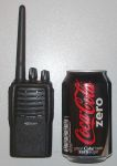 Photo of PT4200 radio next to drink can to show size